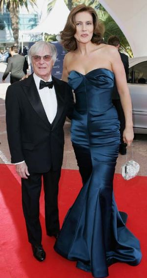 Tall story: formula one boss Bernie Ecclestone is dwarfed by wife Slavica.