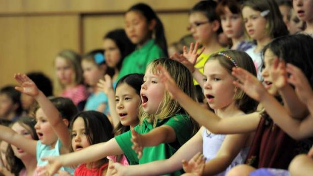 Young students perform a number during their end of day concert.