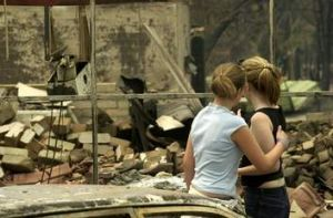 Sisters Ariane and Alex Evans survey the ruins of their family home in Duffy.