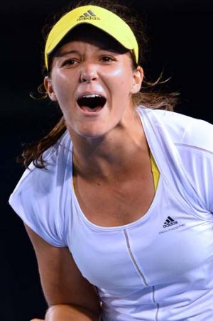 Laura Robson celebrates her victory in her women's singles match against Czech Republic's Petra Kvitova on the fourth ...