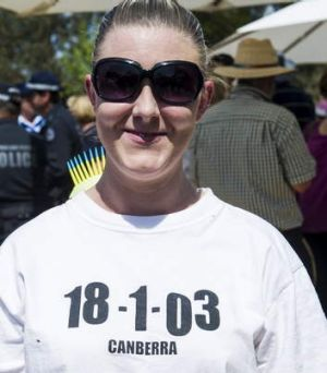 Respect ... Johanna Hauritz wears a t-shirt in tribute to those who helped to fight the fires in January 2003.