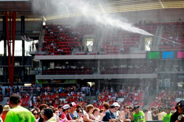 The crowd is treated to a bit of a spray.