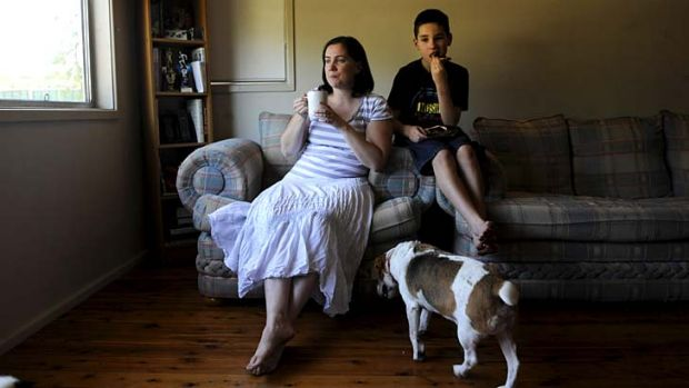 Hurting ... Louise Piltz no longer qualifies for subsidised after-school care for son Cameron, 11.
