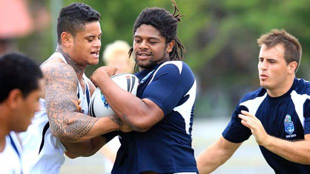 Settled … Jamal Idris, centre, training with the Emerging Blues squad at Redfern Oval on Saturday, said he was ...