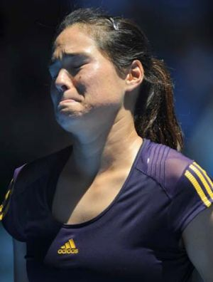 Pain barrier: Jamie Hampton can't hide the torment, losing to Victoria Azarenka.