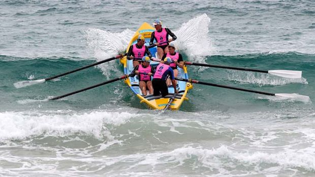 Making a splash ... the fourth round of the Navy Australian Surf Rowers League series at Manly.