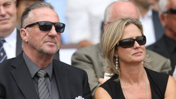 Sir Ian Botham and wife, Kathy at the service for Tony Greig.