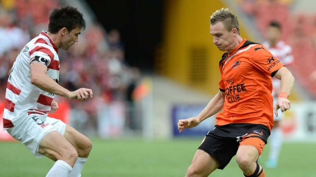 On the attack … Besart Berisha faces Michael Beauchamp in defence for the Western Sydney Wanderers on Sunday.