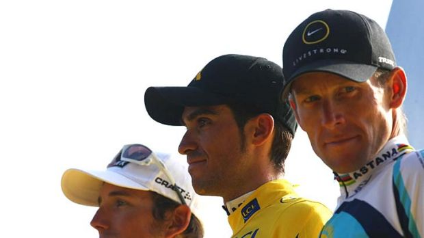The winner of the 2009 Tour de France Alberto Contador (centre), second-placed Andy Schleck (left), and third-placed ...
