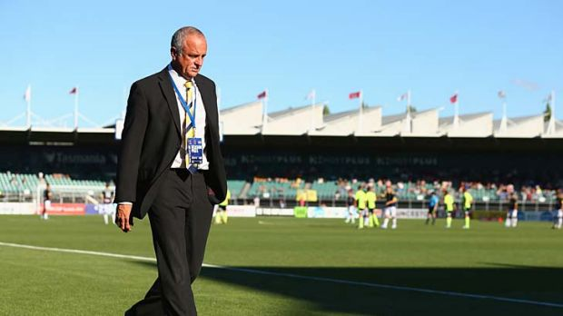 Mariners coach Graham Arnold walks from the ground after he was sent off during the round 16 match against Melbourne ...