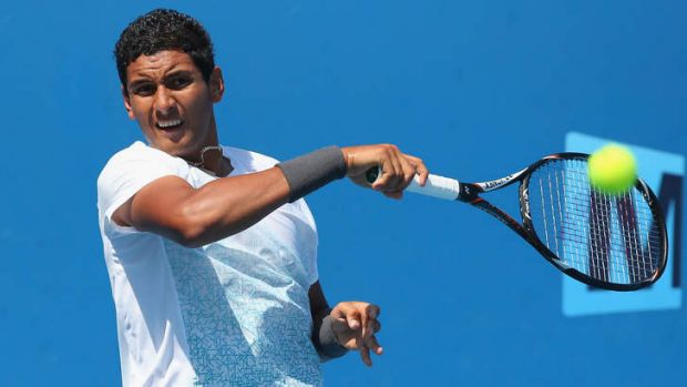 Nick Kyrgios of Australia plays a forehand.