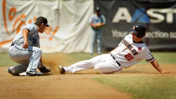 Jeremy Barnes slides into second base only to be tagged out by Blue Sox Trent D'Antonio.