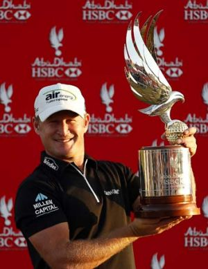 Jamie Donaldson of Wales holds the trophy after winning the Abu Dhabi Golf Championship.
