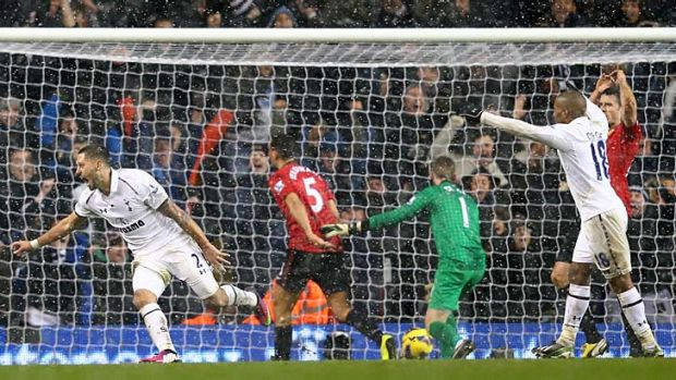 Clint Dempsey celebrates after scoring the equaliser against Manchester United.