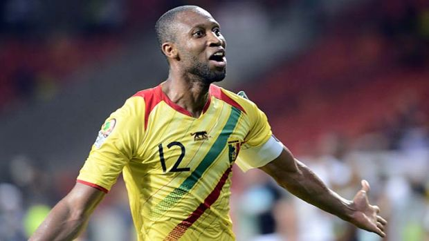 Seydou Keita celebrates after scoring against Niger.