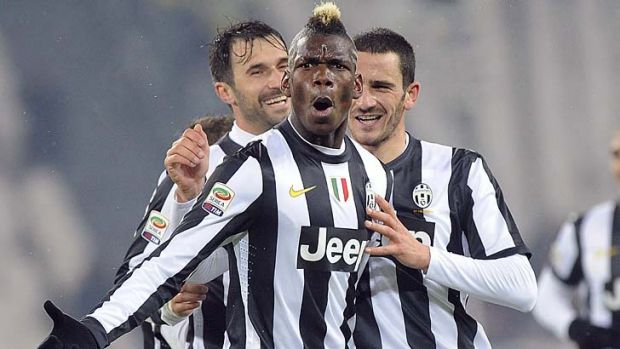 Paul Pogba celebrates with teammates Leonardo Bonucci (right) and Mirko Vucinic after scoring against Udinese.