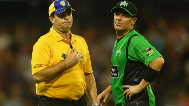 Shane Warne has words with the umpire after James Faulkner bowled a no-ball off the last ball during the BBL semi-final ...