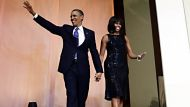 President Barack Obama and first lady Michelle Obama arrive to speak to supporters and donors at an inaugural reception ...