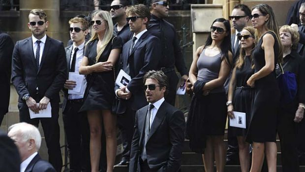 Farewell ... some of the 1000 mourners, including John Ibrahim, on the steps of St Mary's Cathedral and, inset, the ...