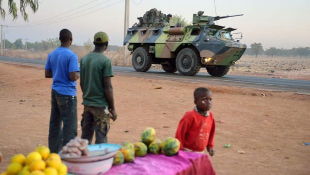 FORMER COLONY: A French armoured vehicle leaves Bamako on deployment to the north of Mali as part of the ''Serval'' ...