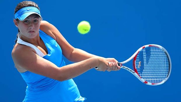 Sara Tomic plays a backhand in her match against Antonia Lottner of Germany.