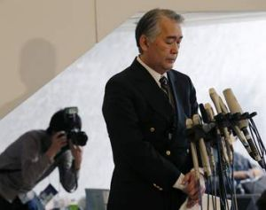 Mourning ... JGC spokesman Takeshi Endo answers questions about the Japanese nationals who were held hostage in Algeria.