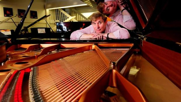 TUNED IN: Tony Magee, manager of DW Music's piano showroom in Fyshwick, says that their acoustic pianos still outsell ...