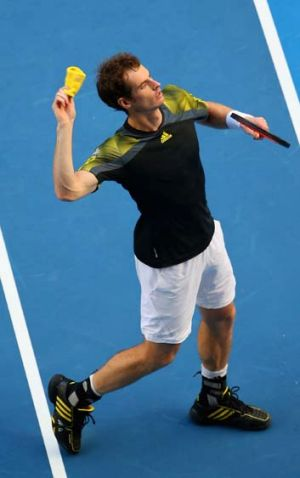 Andy Murray throws his sweat band into the crowd after winnng his fourth round match against Gilles Simon.
