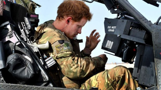 Pilot ... Prince Harry sits in the front seat of his cockpit.