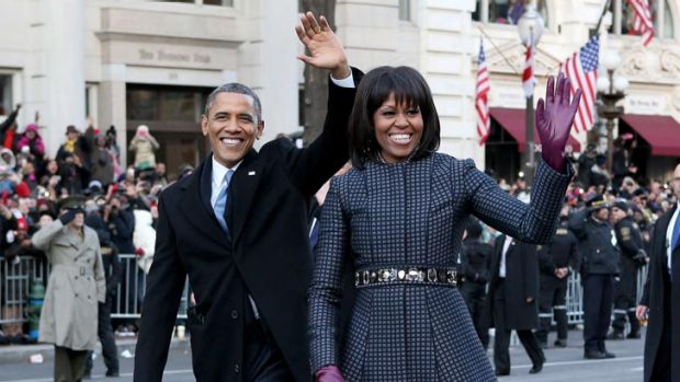 Earlier in the day, Michelle wore a Thom Browne coatdress, teamed with a J Crew belt, to the inauguration parade.