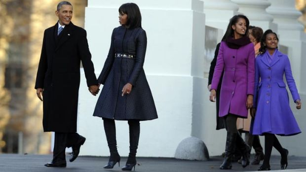 Malia and Sasha wore co-ordinated purple coats as they watched their father make history.