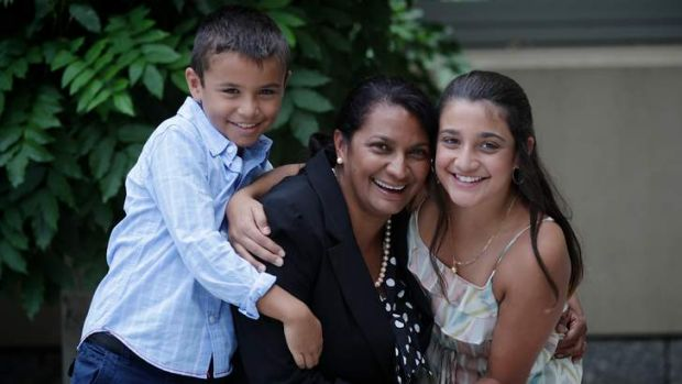 Nova Peris with her children Jack (left) and Destiny (right), at Parliament House in Canberra.