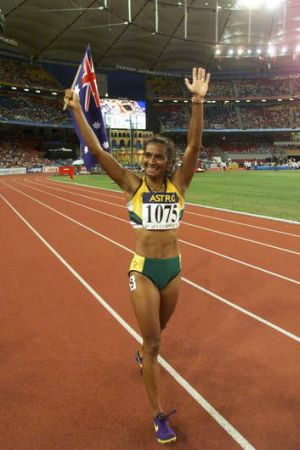 Nova Peris does a lap of honour after the women's 200m final in the 1998 Commonwealth Games.