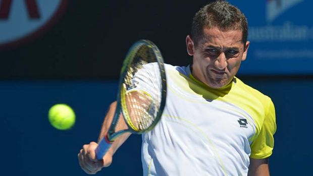 Classy: Nicolas Almagro indulges in a single-handed backhand shot against David Ferrer.