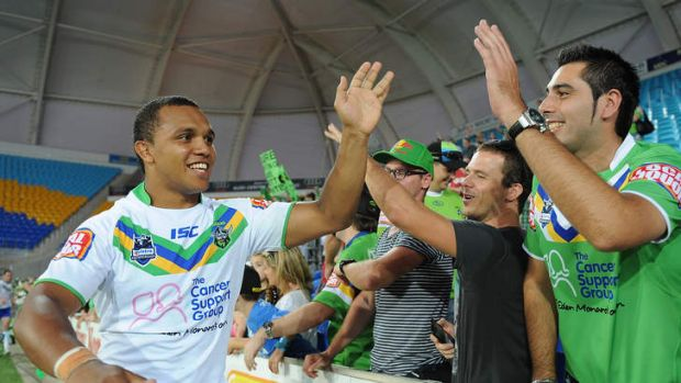 Travis Waddell celebrates with Canberra fans last year. Waddell has been looking for an NRL contract since being ...