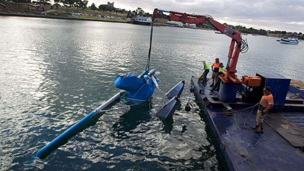 The seaplane is hauled from the bay at Geelong.