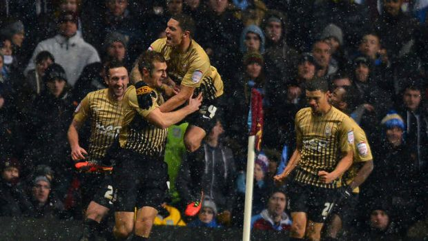 Best loss ever ... Bradford City's English forward James Hanson is swamped after scoring during the second leg ...