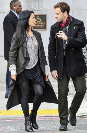 Lucy Lui as Dr Joan Watson and Jonny Lee Miller as Sherlock Holmes on the set of <i>Elementary</i>.