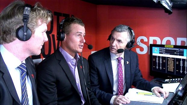 Lleyton Hewitt (centre) in the Channel Seven commentary box at the Australian Open with Jim Courier (left) and Bruce ...