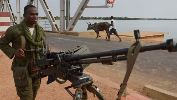 A Malian soldier holds a machine gun near Markala, 270km north of Bamako.