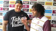 NFL prospect Jesse Williams and Broncos captain Sam Thaiday exchange details