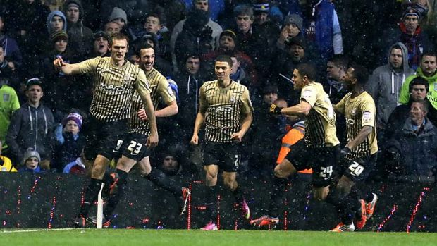 Bantam menace ... James Hanson, left, celebrates with Bradford City teammates after scoring against Aston Villa on Tuesday.