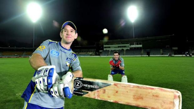 ACT Comets batsman Aaron Ayre,20 of Turner and wicket keeper, Beau McClintock,19 of Harrison under the new light at ...