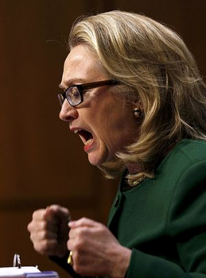 U.S. Secretary of State Hillary Clinton pounds her fists as she responds to intense questioning over the Benghazi attack.