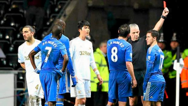 Eden Hazard of Chelsea, right, is sent off by referee Chris Foy.