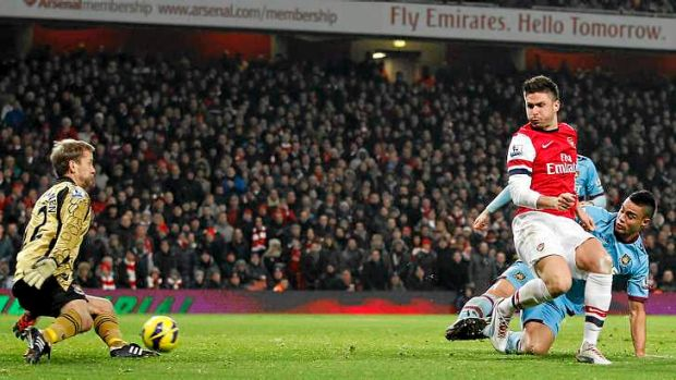 Arsenal striker Olivier Giroud scores his second and Arsenal's fifth goal.