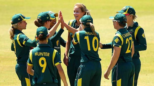 Ellyse Perry (centre) celebrates a wicket.