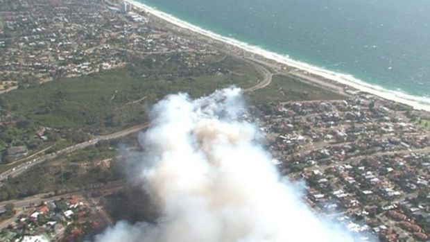 Residents are being evacuated and roads are closed around the bushfire.
