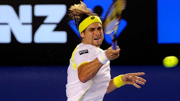David Ferrer returns a shot to Novak Djokovic at Rod Laver Arena.