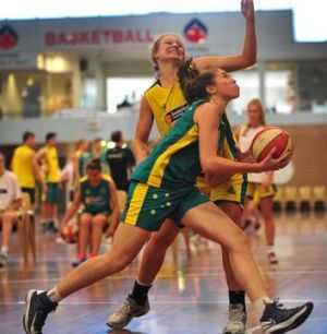 Megan Mackay defends whilst Brydie Kennedy-Hoparte aims to shoot.